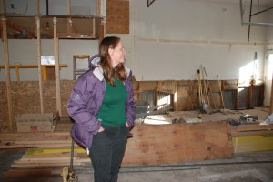 Claire Jacobi inspects construction on  Literacy Outreach and the Teo Prinster Learning Center renovation.